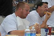 """Matt Zeblo and Mark Thomas devour hotdogs during the Bright Leaf Hot Dog Eating Contest on Sunday, July 3, 2011. """"I've been training for this all my life,"""" said Thomas."""