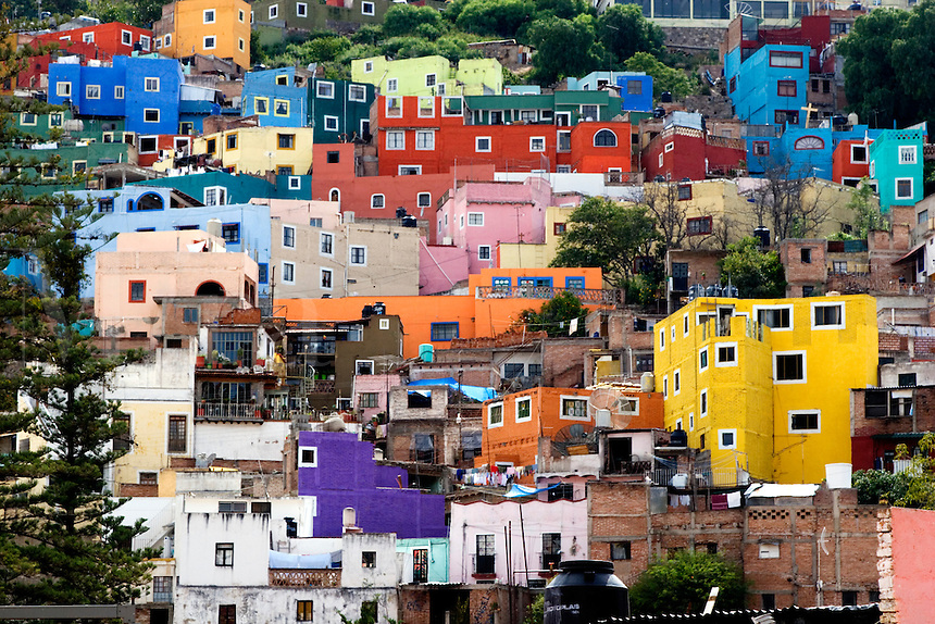 The HOUSES of the HISTORICAL town of GUANAJUATO are painted bright colors - MEXICO