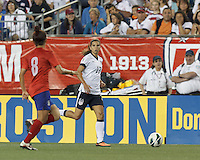 USWNT midfielder Tobin Heath (17) looks to pass. In an international friendly, the U.S. Women's National Team (USWNT) (white/blue) defeated Korea Republic (South Korea) (red/blue), 4-1, at Gillette Stadium on June 15, 2013.