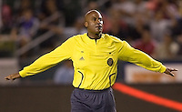 Center referee Richard Heron presents a red card during a MLS match. The San Jose Earthquakes and Chivas USA played to 0-0 draw at Home Depot Center stadium on Saturday, August 23, 2008.