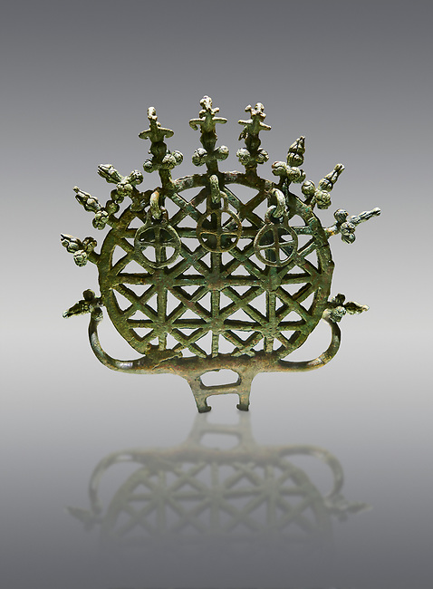 """Bronze Age Hattian ceremonial standard known as """"Sun Disks"""" from Bronze Age grave BM (2500 BC to 2250 BC), possibly a Royal grave - Alacahoyuk - Museum of Anatolian Civilisations, Ankara, Turkey. Against a gray background"""