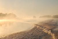 Boat wake, wind, trees and fog on the intercoastal waterway near Appalatchicola, Florida