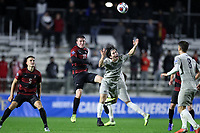 CARY, NC - DECEMBER 13: Gabe Segal #17 of Stanford University and Paul Rothrock #3 of Georgetown University challenge for a header during a game between Stanford and Georgetown at Sahlen's Stadium at WakeMed Soccer Park on December 13, 2019 in Cary, North Carolina.
