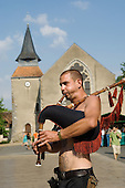 Street performer plays the bagpipes (cornemuse) in front of the village church in Saint Chartier during the 31st International Festival of Luthiers and Maitres Sonneurs.
