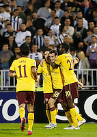 Arsenal player Sebastiien Squillaci, center, celebrate goal with teammates, Johan Djourou, left, Carlos Vela,  during  UEFA Champions league match in group H FC Partizan Belgrade Vs. Arsenal, London, Serbia, Monday, Sept. 28, 2010.  (Srdjan Stevanovic/Starsportphoto.com)