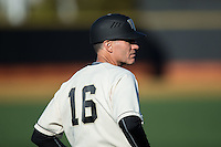 Wake Forest Demon Deacons head coach Tom Walter (16) coaches third base during the game against the Richmond Spiders at David F. Couch Ballpark on March 6, 2016 in Winston-Salem, North Carolina.  The Demon Deacons defeated the Spiders 17-4.  (Brian Westerholt/Four Seam Images)