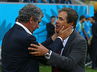Greece coach Fernando Santos and Costa Rica coach Jorge Luis Pinto embrace before kick off