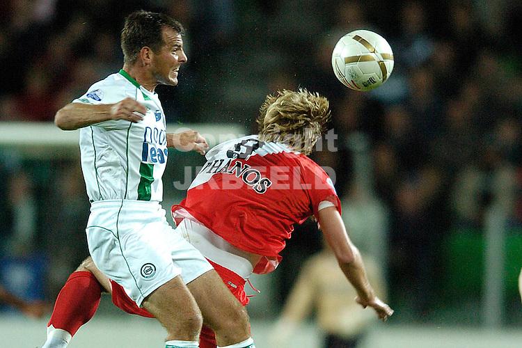 groningen - fc utrecht  eredivisie seizoen 2007-2008 14-09- 2007 matthijs wint kopduel van broerse