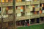 Youths drug dealing in run down council estate high rise apartment block. Otterburn Close in Hulme, Manchester, UK 1993.