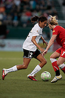 Christen Press of the magicJack, left dribbles against McCall Zerboni (7) of the Western New York Flash during second half action. The Western New York Flash defeated the magicJack 3-0 in Women's Professional Soccer (WPS) at Sahlen's Stadium in Rochester, NY May 22, 2011.