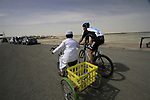 Local boy gives Sky Procycling's Juan Antonio Flecha (ESP) a run for his money before the start of Stage 4 of the 2012 Tour of Qatar from Al Thakhira to Madinat Al Shamal, Qatar. 8th February 2012.<br /> (Photo Eoin Clarke/Newsfile)