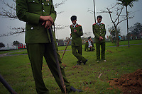 Vietnamese security forces pause between planting trees in Kim Lien, VIetnam on 21 February 2010.