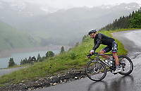 Peter Sagan (SVK/BORA - hansgrohe) descending the Col du Pré (HC/1748m) towards the Barrage de Roselend in, yet again, grim conditions.<br /> <br /> Stage 9 from Cluses to Tignes (145km)<br /> 108th Tour de France 2021 (2.UWT)<br /> <br /> ©kramon