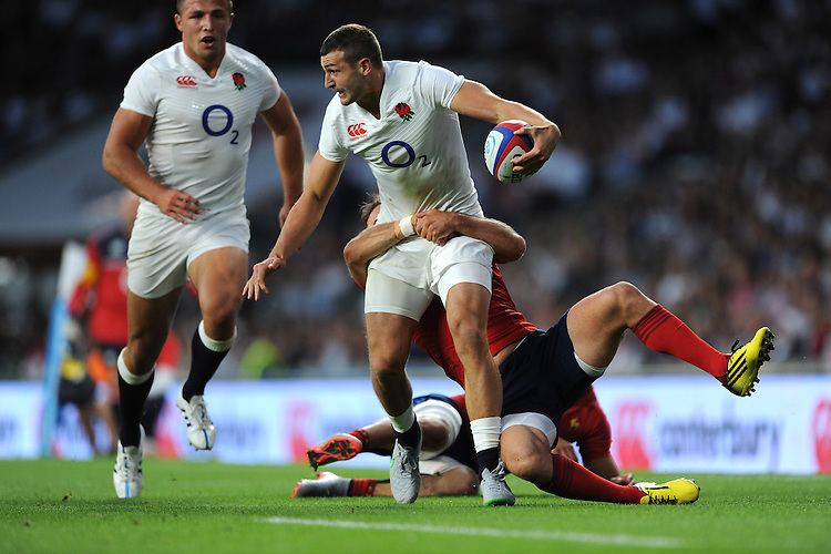 Jonny May of England looks to offload as he is tackled by Morgan Parra and Sofiane Guitoune of France - 15/08/2015 - Twickenham Stadium - London <br /> Mandatory Credit: Rob Munro/Stewart Communications