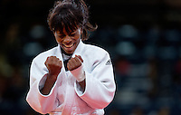 29 JUL 2012 - LONDON, GBR - Priscilla Gneto (FRA) (left) of France celebrates her win over Ilse Heylen (BEL) of Belgium in their women's -52kg category bronze medal contest at the London 2012 Olympic Games judo at the ExCel Exhibition Centre in London, Great Britain(PHOTO (C) 2012 NIGEL FARROW)