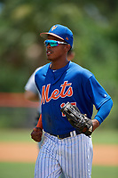 GCL Mets left fielder Wilmer Reyes (17) jogs back to the dugout during a game against the GCL Marlins on August 3, 2018 at St. Lucie Sports Complex in Port St. Lucie, Florida.  GCL Mets defeated GCL Marlins 3-2.  (Mike Janes/Four Seam Images)