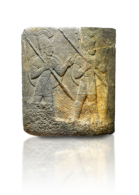 Picture & image of Hittite relief sculpted orthostat stone panel of Herald's Wall. Limestone, Karkamıs, (Kargamıs), Carchemish (Karkemish), 900-700 B.C. Military parade. Anatolian Civilisations Museum, Ankara, Turkey.<br /> <br /> Three helmeted soldiers in short skirts carry the shield on their backs and the spears in their hands. The bottom right part of the relief was left untreated since the pedestal stood in front of it. <br /> <br /> Against a white background.