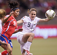 Heather O'Reilly, right, of the United States battles Shirley Cruz of Costa Rica for the ball during play in the CONCACAF Olympic Qualifying semifinal match at BC Place in Vancouver, B.C., Canada Friday Jan. 27, 2012. The United States won the match 3-0 to earn a berth in 2012 London Olympics.
