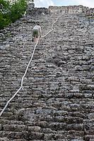 Nohoch Mul, the main pyramid at the Coba Ruins, near Playa del Carmen, Yucatan, Mexico.  Climber making his way to the top.
