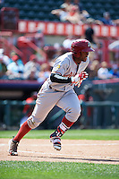 Altoona Curve left fielder Barrett Barnes (17) runs to first after laying down a bunt during a game against the Erie SeaWolves on July 10, 2016 at Jerry Uht Park in Erie, Pennsylvania.  Altoona defeated Erie 7-3.  (Mike Janes/Four Seam Images)