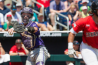 TCU Horned Frogs catcher Evan Skoug (9) makes a throw to first base against the Texas Tech Red Raiders in Game 3 of the NCAA College World Series on June 19, 2016 at TD Ameritrade Park in Omaha, Nebraska. TCU defeated Texas Tech 5-3. (Andrew Woolley/Four Seam Images)