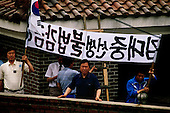 """Seoul, South Korea<br /> June 24, 1987<br /> <br /> Kim Dea-jong (trimming tree) in his backyard under house arrest as opposition leader to the ruling party. <br /> <br /> <br /> Kim Dae-jung (3 December 1925 to 18 August 2009) was President of South Korea from 1998 to 2003, and the 2000 Nobel Peace Prize recipient. As of this date Kim is the first and only Nobel laureate to hail from Korea. A Roman Catholic since 1957, he has been called the """"Nelson Mandela of Asia"""" for his long-standing opposition to authoritarian rule."""