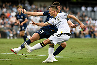 3rd January 2021; Campbelltown Stadium, Leumeah, New South Wales, Australia; A League Football, Macarthur FC versus Central Coast Mariners; Denis Genreau of Macarthur FC crosses as Lewis Miller of Central Coast Mariners tries to block