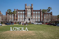New Orleans, Louisiana.  Loyola University, Students Sitting on the Lawn, Marquette Hall behind them. Uptown District.
