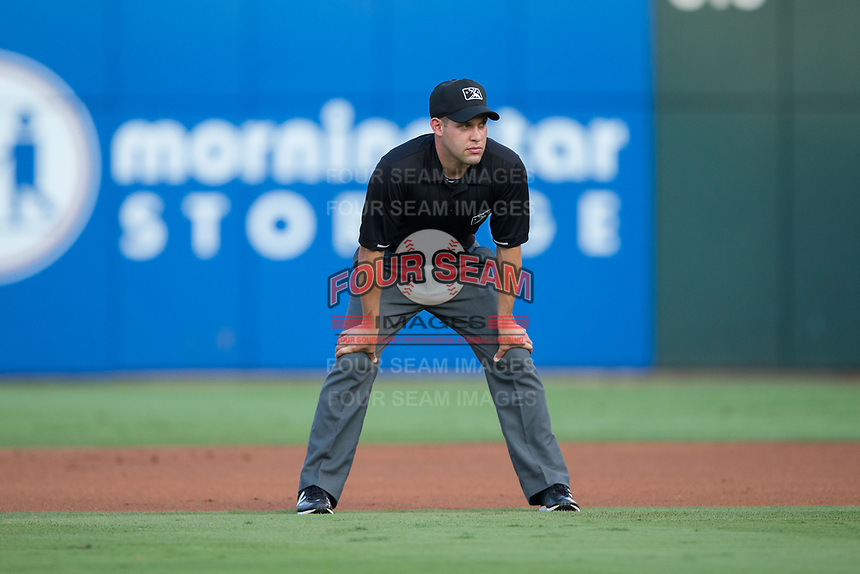 Umpire Dan Merzel handles the calls at second base during the International League game between the Indianapolis Indians and the Charlotte Knights at BB&T BallPark on June 16, 2017 in Charlotte, North Carolina.  The Knights defeated the Indians 12-4.  (Brian Westerholt/Four Seam Images)