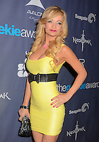 Mindy Robinson<br /> The first annual Geekie Awards at The Avalon Hollywood in Hollywood, CA., USA.  <br /> August 18th, 2013<br /> half length yellow dress hand on hip sleeveless black belt cleavage clutch bag<br /> CAP/ADM/BT<br /> ©Birdie Thompson/AdMedia/Capital Pictures