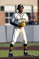 Michigan Wolverines pitcher Angelo Smith (40) on the mound against the Michigan State Spartans on March 21, 2021 in NCAA baseball action at Ray Fisher Stadium in Ann Arbor, Michigan. Michigan scored 8 runs in the bottom of the ninth inning to defeat the Spartans 8-7. (Andrew Woolley/Four Seam Images)