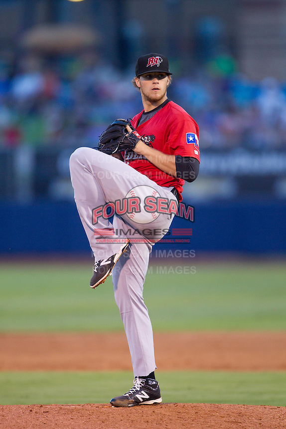 Frisco RoughRiders pitcher Jake Thompson (29) winds up on the mound during the Texas League game against the Tulsa Drillers at ONEOK field on August 15, 2014 in Tulsa, Oklahoma  The RoughRiders defeated the Drillers 8-2.  (William Purnell/Four Seam Images)