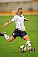 Heather Mitts strikes the ball. The USA defeated Norway 2-1 at Olhao Stadium on February 26, 2010 at the Algarve Cup.
