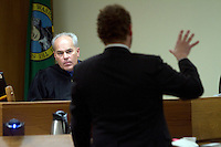 Judge Erik Rohrer listens to arguments from attorney Derek Medina in the Clallum County Superior Court in Port Angeles, WA on December 20, 2013. Heather Enajibi, President of the Animal Aid and Rescue Foundation (AARF) was suing the Olympic Animal Sanctuary (OAS) and its owner Stephen Markwell to get her dog, Leroy, back.    Enajibi won and Markwell was ordered to return the dog.  <br />  Owner Steve Markwell Markwell has been under fire for neglecting the dogs after volunteers filed a complaint in 2012. The City of Forks police department investigated and found horrific conditions but said legally they were unable to do anything about it. Markwell claims he has 125 dogs inside and believes he is their last hope.  Many of the dogs were turned over to him by rescues and shelters who deemed them dangerous. Mounting evidence of animal cruelty has prompted many of them to ask for their dogs back.  Markwell refuses and only lets a few trusted volunteers enter the premises.