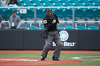 Home plate umpire Mac Smith calls a batter out on strikes during the NCAA baseball game between the San Diego State Aztecs and the UNCG Spartans at Springs Brooks Stadium on February 16, 2020 in Conway, South Carolina. The Spartans defeated the Aztecs 11-4.  (Brian Westerholt/Four Seam Images)