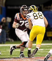 Andrew Lanier of Virginia Tech runs the ball during Sugar Bowl game against Michigan at Mercedes-Benz SuperDome in New Orleans, Louisiana on January 3rd, 2012.  Michigan defeated Virginia Tech, 23-20 in first overtime.