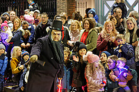 """Pictured: A festive character amuses the gathered crowds that gather to watch the Christmas parade in Swansea, Wales, UK. Sunday 19 November 2018<br /> Re: Swansea Christmas parade attended by thousands has been branded a """"shambles"""" for having just three floats.<br /> The annual festive event in south Wales, which took place on Sunday, promised """"dynamic dance-troupes"""" as well as """"spectacular shows and stages"""".<br /> But the parade was scaled down, leading to a barrage of criticism on social media because of roadworks in the city centre. <br /> The leader of Swansea Council, Rob Stewart apologised on Facebook and said the parade was not """"good enough"""".<br /> Parents took on social media to voice their anger, calling the event """"a load of rubbish"""" and claiming there was nothing for young children apart from """"a loud music float with Santa on""""."""