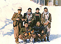 Iraq 1980 .3rd from Left, Hatige Yachar, in front her house, the Red Palace, in Shene with her peshmergas  .Irak 1980 .Hatige Yachar devant sa maison, le Palais Rouge a Shene, avec ses peshmergas