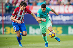 Luis Suarez (r) of FC Barcelona battles for the ball with Stefan Savic of Atletico de Madrid during their La Liga match between Atletico de Madrid and FC Barcelona at the Santiago Bernabeu Stadium on 26 February 2017 in Madrid, Spain. Photo by Diego Gonzalez Souto / Power Sport Images