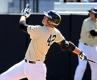 UCF Knights first baseman D.J. Hicks #42 hits a home run during a game against the Siena Saints at the UCF Baseball Complex on March 4, 2012 in Orlando, Florida.  Central Florida defeated Siena 15-2.  (Mike Janes/Four Seam Images)