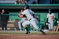 West Virginia Black Bears left fielder Edison Lantigua (18) follows through on a swing during a game against the Batavia Muckdogs on June 20, 2018 at Dwyer Stadium in Batavia, New York.  West Virginia defeated Batavia 4-3.  (Mike Janes/Four Seam Images)
