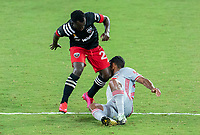 WASHINGTON, DC - SEPTEMBER 12: Mohammed Abu #25 of D.C. United collides with Cristian Cásseres Jr. #23 of the New York Red Bulls during a game between New York Red Bulls and D.C. United at Audi Field on September 12, 2020 in Washington, DC.