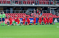 WASHINGTON, DC - APRIL 17: D.C. United kneels during the national anthem before a game between New York City FC and D.C. United at Audi Field on April 17, 2021 in Washington, DC.
