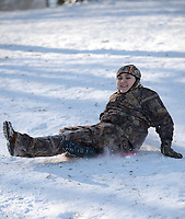 David Newton, 10, of Prairie Grove laughs Friday, Feb. 19, 2021, as he slides downhill on a storage container lid while sledding with his family at Battlefield State Park in Prairie Grove. The Newtons were taking a break from virtual instruction to take advantage of the good sledding conditions before warm temperatures melted the snow from the hillside. Visit nwaonline.com/210220Daily/ for today's photo gallery. <br /> (NWA Democrat-Gazette/Andy Shupe)