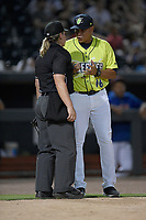 Manager Pedrom Lopez (16) of the Columbia Fireflies discusses a call with home plate umpire Jennifer Pawol in a game against the Augusta GreenJackets on Friday, May 31, 2019, at Segra Park in Columbia, South Carolina. Augusta won, 8-6. (Tom Priddy/Four Seam Images)