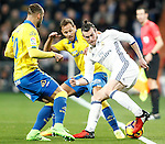 Real Madrid's Gareth Bale (r) and UD Las Palmas' Jese Rodriguez (l) and Dani Castellano during La Liga match. March 1,2017. (ALTERPHOTOS/Acero)