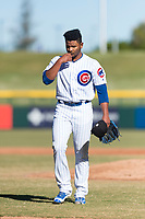 Mesa Solar Sox relief pitcher Manuel Rondon (51), of the Chicago Cubs organization, kisses his hand as he walks off the field between innings of an Arizona Fall League game against the Surprise Saguaros at Sloan Park on November 15, 2018 in Mesa, Arizona. Mesa defeated Surprise 11-10. (Zachary Lucy/Four Seam Images)