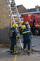 Firefighters wearing BA training with ladders. This image may only be used to portray the subject in a positive manner..©shoutpictures.com..john@shoutpictures.com