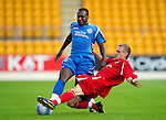 St Johnstone v Morton..24.08.10  CIS Cup Round 2.Cleveland Taylor tackled by Natahn Shepherd.Picture by Graeme Hart..Copyright Perthshire Picture Agency.Tel: 01738 623350  Mobile: 07990 594431