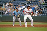 Designated hitter Nick Yorke (4) of the Greenville Drive takes a lead off first in a game against the Hickory Crawdads on Thursday, August 26, 2021, at Fluor Field at the West End in Greenville, South Carolina. (Tom Priddy/Four Seam Images)